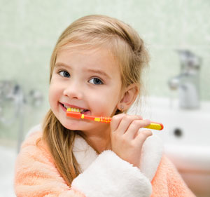 girl-brushing-teeth-with-toothpaste